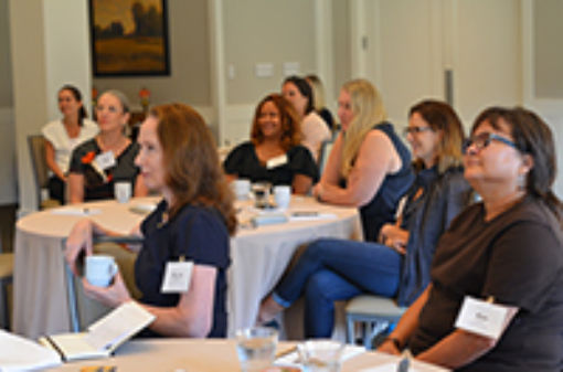 Attendees participate in the Women's Resilience Forum kick-off event